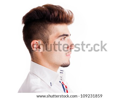 Young man profile close-up portrait. Space to insert text. - stock photo