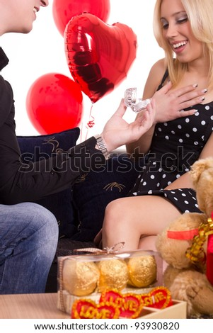 Young man propose marriage to beautiful girl - stock photo