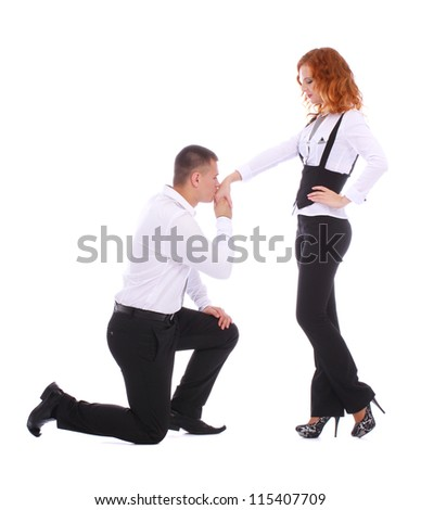 Young man proposing to a woman while standing on one knee and kissing her hand isolated on white background