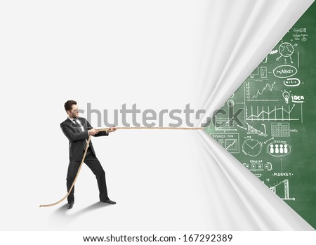 young man pulling rope and drawing  business concept - stock photo