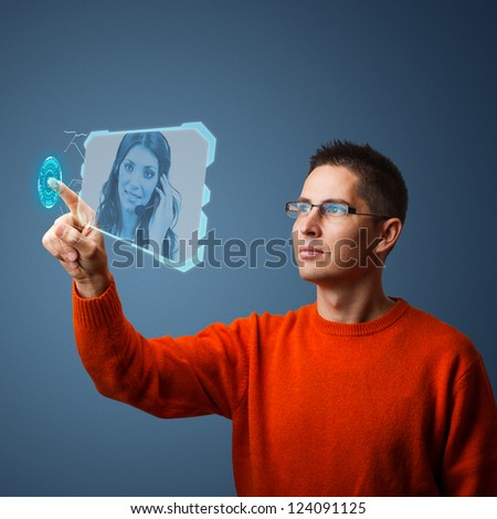 Young man pushing digital button on tablet screen - stock photo