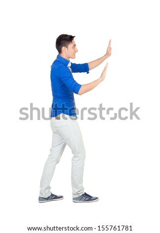 Young man pushing with blue shirt isolated on white background - stock photo