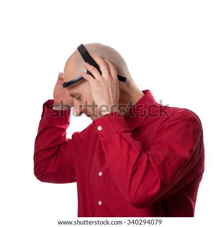 Young man puts on head headset EEG (electroencephalography). Isolated on white background.  - stock photo