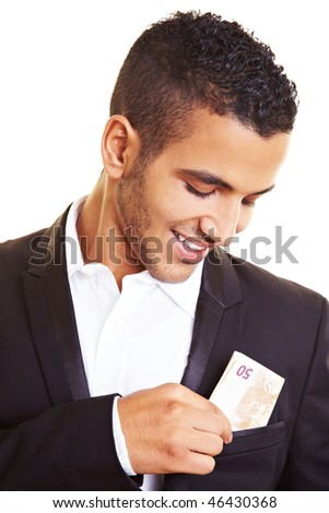 Young man putting banknotes in his jacket pocket