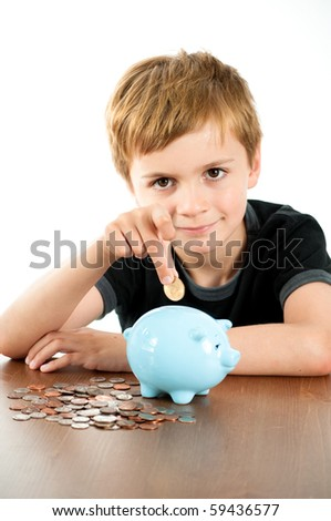 Young Man Putting Money into Blue Piggy Bank - stock photo