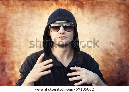 young man rapper on grunge background