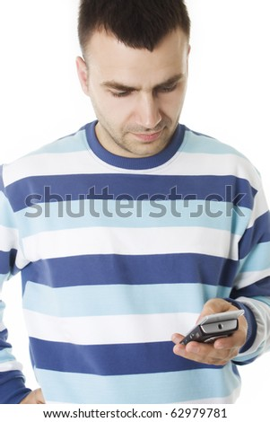 Young man read a message on the cell phone, isolated on white - stock photo