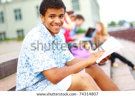 young man read book - stock photo