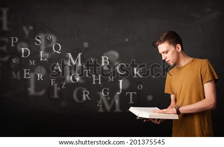 Young man reading a book with alphabet letters coming out of the book - stock photo