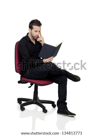 Young Man Reading Book Over White Background - stock photo