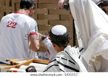 Young man reading from the Thora during his Bar Mitzvah at the western Wall.Jerusalem,Israel - stock photo