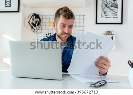 Young man reading important documents