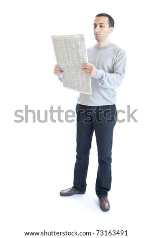 Young man reading newspaper - stock photo