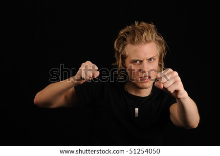 Young man ready for battle - stock photo