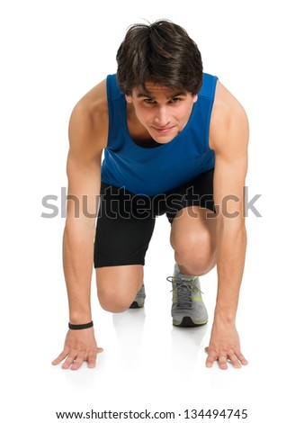Young Man Ready To Start A Race Isolated On White Background - stock photo