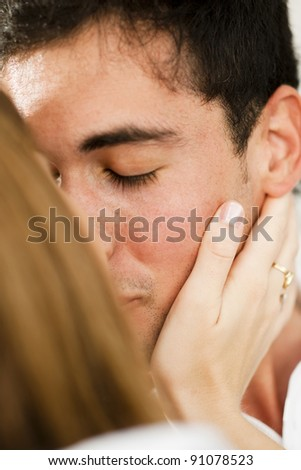 Young man receveing caress, his eyes closed - stock photo