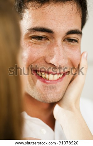 Young man receving caress - stock photo