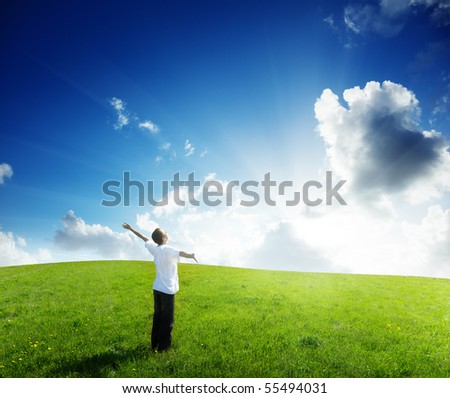 young man relax on the green field - stock photo