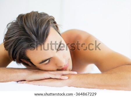 Young man relaxed in spa - stock photo