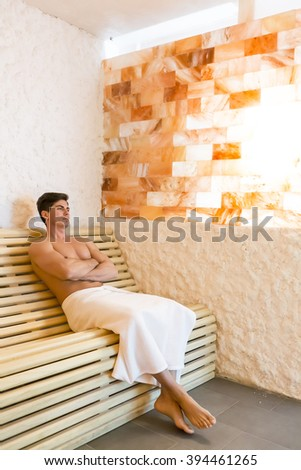 Young man relaxing in a salt room in the spa - stock photo