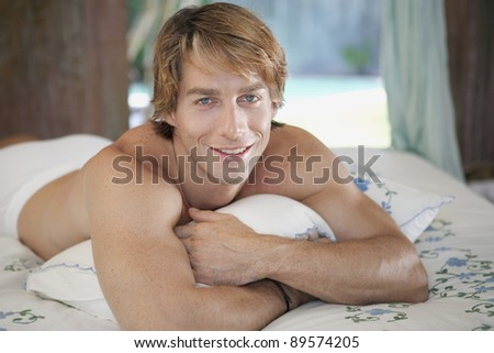 Young man relaxing in hotel room on vacation. - stock photo