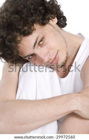 Young man relaxing in white - stock photo