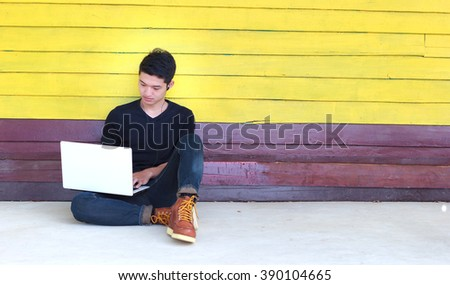 Young man relaxing multitasking multimedia man using devices at home(color toned image)  - stock photo