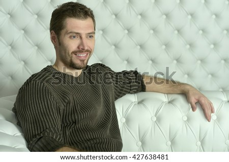 young man relaxing  on sofa - stock photo