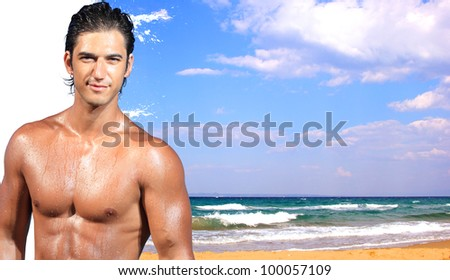 young man relaxing on the beach - Travel concept - stock photo