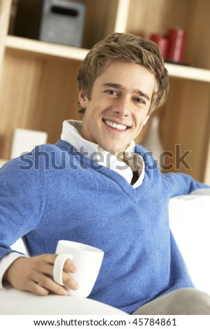 Young Man Relaxing With Cup Of Coffee - stock photo