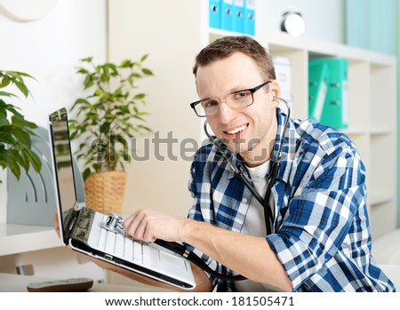 young man repairing a computer office - stock photo