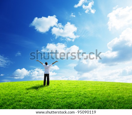 young man rest on field - stock photo