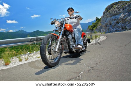 Young man riding a chopper - stock photo