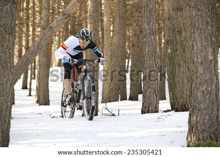 Young man riding a mountain bike - stock photo