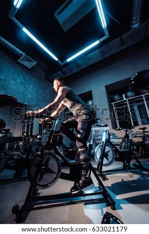 Young Man Riding Exercise Bike Guy Stock Photo 633021089
