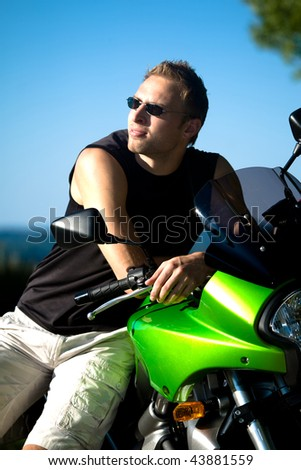 young man riding the motorcycle - stock photo