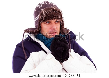 Young man rubbing his hands from cold in wintertime - stock photo