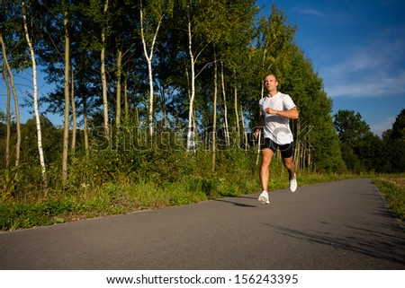 Young man running - stock photo