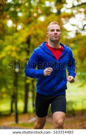 Young man running  - stock photo