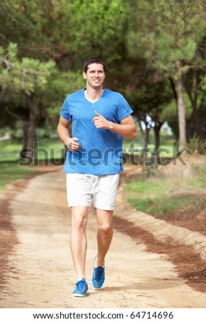 Young man running in park