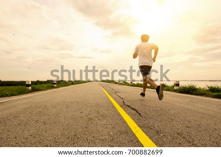young man running on the street in the morning.