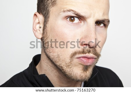 young man's face, intense look