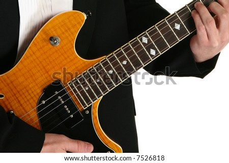 Young man's hands on electric guitar.