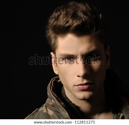 Young man's portrait. Close-up face. - stock photo
