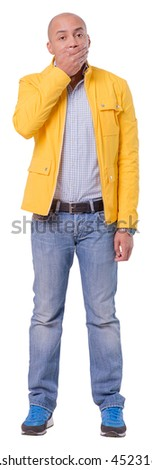 Young man said something wrong. He is covering mouth with a right hand at the moment. Full length cutout photo. Isolated on white background. - stock photo