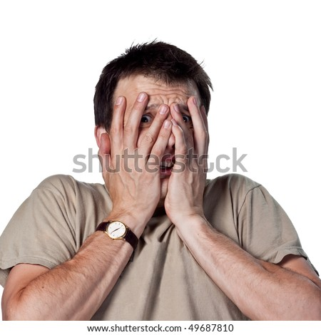 Young man, scared of something - stock photo