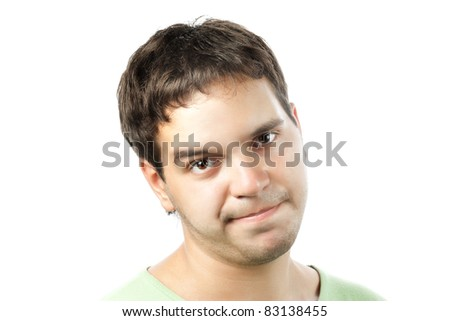 young man sceptically looking isolated on white background - stock photo