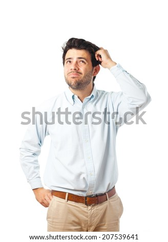 young man scratching head on a white background - stock photo