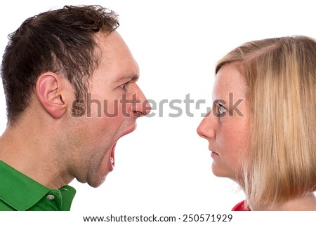 young man scream at so his wife in front of white background - stock photo