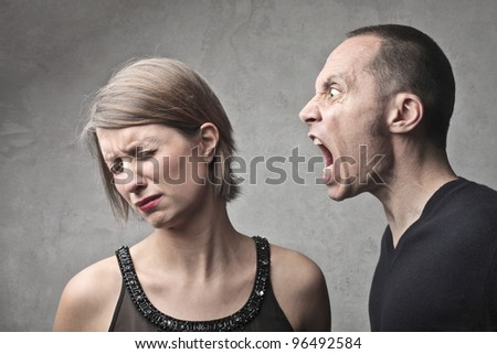 Young man screaming against a sad young woman